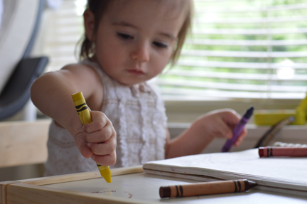 child with crayon